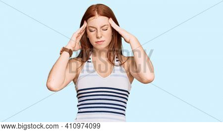 Young read head woman wearing casual clothes with hand on head for pain in head because stress. suffering migraine.