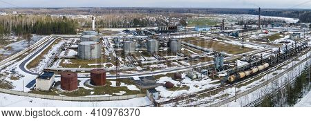 Aerial Drone Image Of Street Asphalt Factory Company. Industry Bitumen Storage From Above. Productio