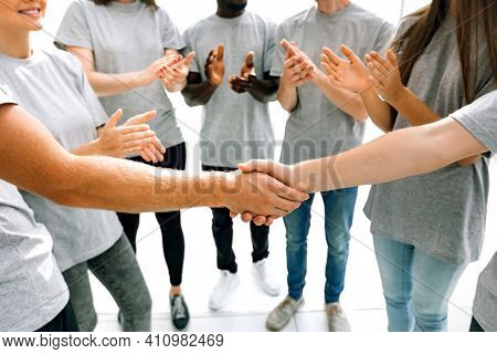Close Up. The Handshake Of The Delegates Of The Youth Summit Students