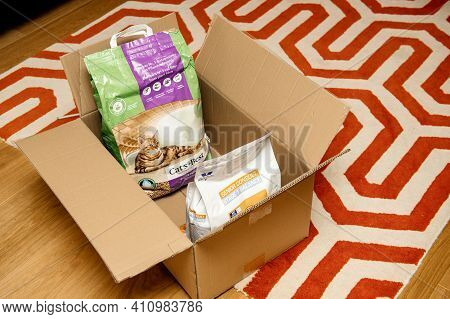 Strasbourg, France - Jan 16, 2021: Living Room Carpet With Cardboard Box Delivery Containing Cats Be