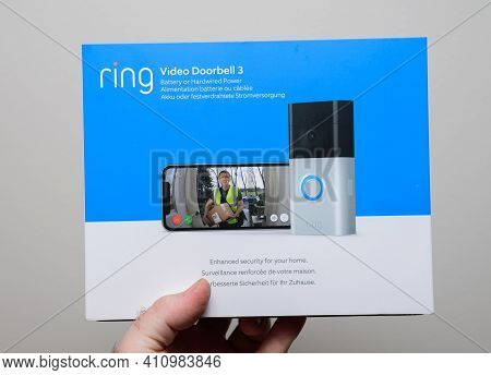 Paris, France - Feb 21, 2021: Pov Male Hand Holding Isolated On White Background Package Of New Late