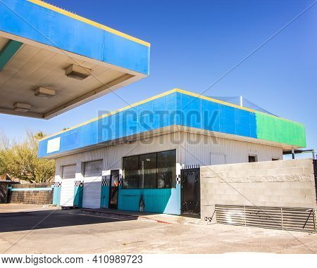 Abandoned Garage Building With Roll Up Doors & Outside Overhang