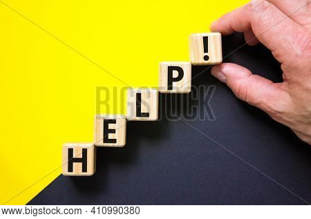 Support And Help Symbol. Wooden Cubes With The Word 'help'. Businessman Hand. Business, Psychology,