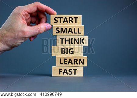 Start Small Think Big Symbol. Words 'start Small Think Big Learn Fast' On Wooden Blocks On A Beautif