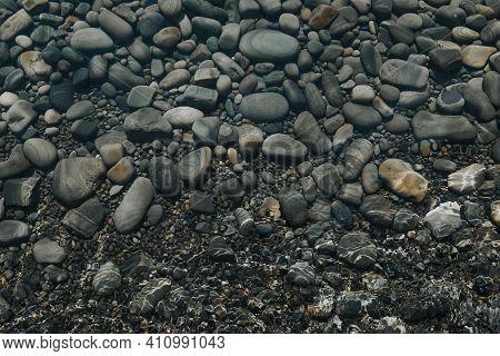 Pure Sea Water Of The Black Sea. Pebble Sea Shore Background.