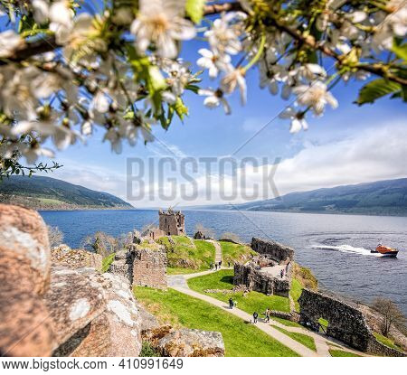 Ruins Of Urquhart Castle With Famous Lake Loch Ness In Scotland