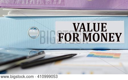 Value For Mone Text Written On Folder With Documents And Calculator.