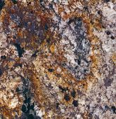 Surface of the granite with white brown yellow and black tint for background poster
