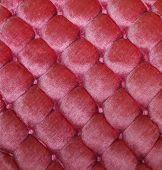 Vintage pink button tufted velvet background texture. poster