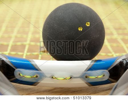 Double Yellow Dot Squash Ball On Racket