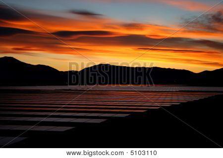 Solar Panels And Sunrise