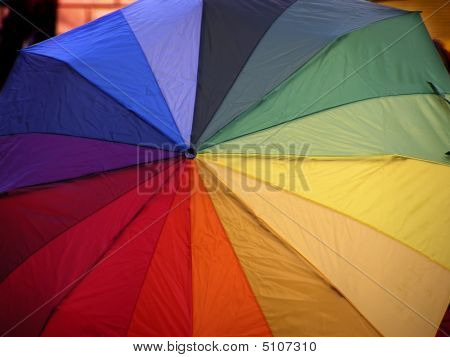 Opened funny umbrella with all rainbow colours. poster