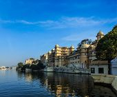 Romantic India luxury tourism concept background - Udaipur City Palace and Lake Pichola. Udaipur, Rajasthan, India poster