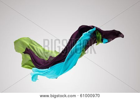 abstract pieces of fabric floating, high-speed studio shot