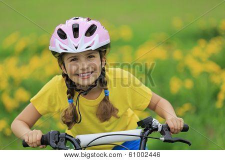 Bike riding - young girl on bike