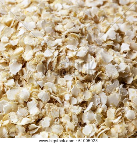 Quinoa flakes in full-frame closeup.