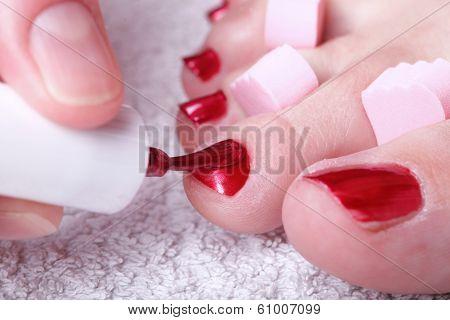 Female Feet Red Polished Nails