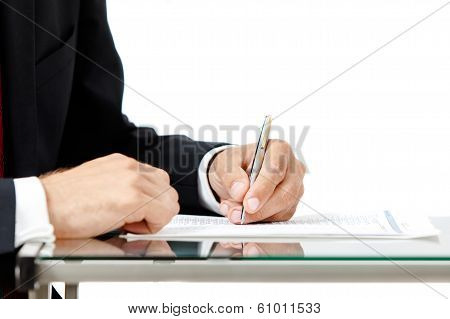Close-up Of Business Man Signing A Contract