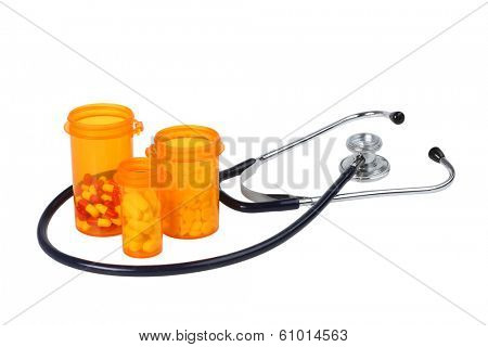Stethoscope and pill bottles, cutout on white background