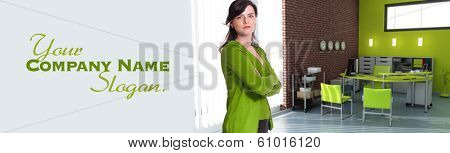 Woman standing in an office in green shades