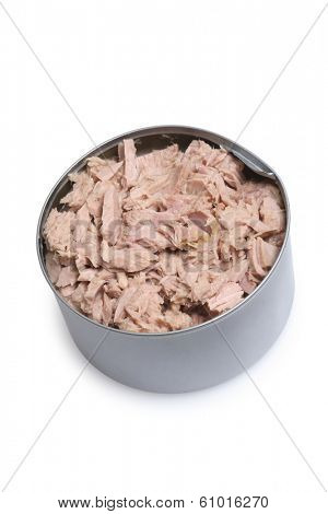 Pot full of tuna fish meat on white background