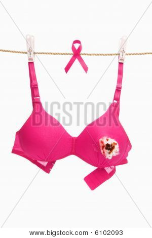 Broken Pink Bra With Ribbon For Breast Cancer Concept