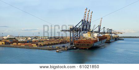 large panorama of loading docks at freeport, bahamas