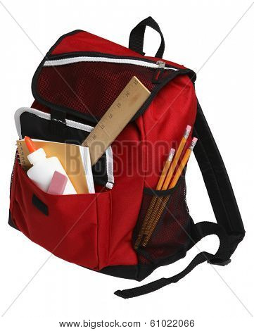 Back to School still life with red backpack and school supplies on white