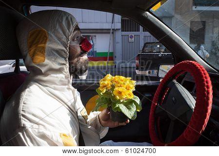 Clown Driving His Car At Milan Clown Festival 2014