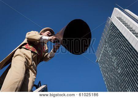 Performer Calls People Using A Vintage Loudhailer At Milan Clown Festival 2014