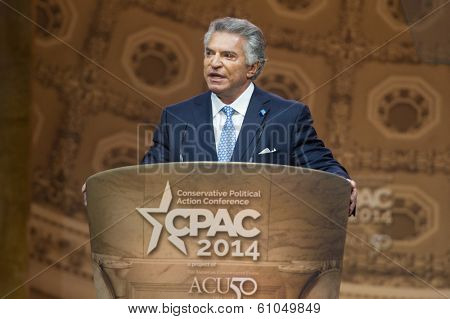NATIONAL HARBOR, MD - MARCH 7, 2014: Al Cardenas, lobbyist and chairmen of the American Conservative Union, speaks at the Conservative Political Action Conference (CPAC).