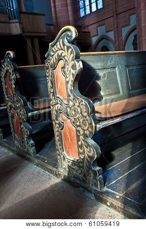 WETZLAR, GERMANY - JUNE 3, 2012: old wooden empty historic benches in the cathedral of Wetzlar