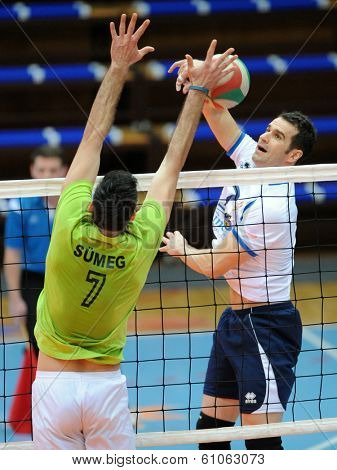 KAPOSVAR, HUNGARY - FEBRUARY 25: Andras Geiger (white 7) in action at a Hungarian National Championship volleyball game Kaposvar (white) vs. Sumeg (green), February 25, 2014 in Kaposvar, Hungary.