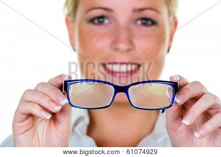 a woman holding glasses in hand. symbolic photo for bad vision and refractive error