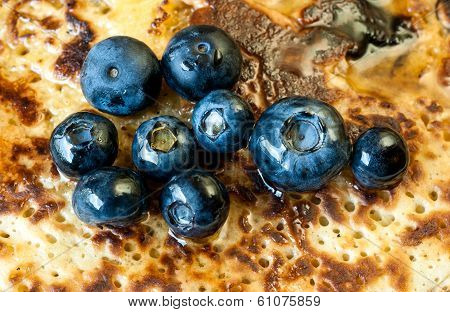 Blueberries on pancakes closeup