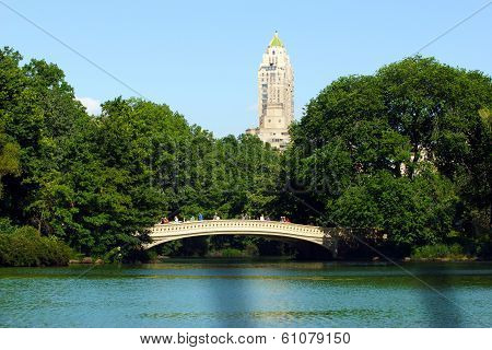 A Bridge With People Walking Across It In Central Park