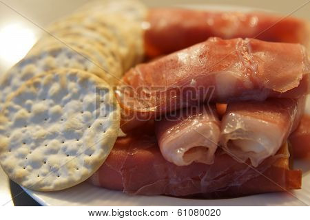 A Platter Of Meat And Cheese And Crackers