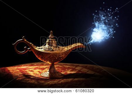 Magic lamp from the story of Aladdin with Genie appearing in blue smoke concept for wishing, luck and magic poster