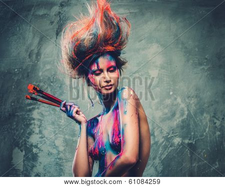 Young woman muse with creative body art and hairdo holding paint brushes  poster
