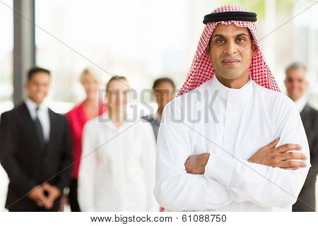 Arabian businessman with colleagues on background