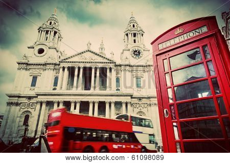 St Paul's Cathedral in London, the UK. Red bus and telephone booth, cloudy sky. Symbols of London in vintage, retro style