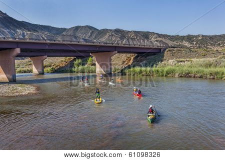 DOTSERO, CO - AUGUST 19: Stand up paddleboards, kayaks and canoes in the annual Colorado River Race in the Glanwood Canyon, August 19, 2012
