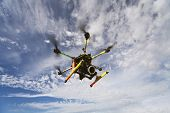 Takingaero photo using octocopter flying drone with slr camera poster