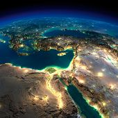 Highly detailed Earth illuminated by moonlight. The glow of cities sheds light on the detailed exaggerated terrain. Night Earth. Africa and Middle East. Elements of this image furnished by NASA poster