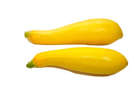Two Yellow Summer Squash Over White