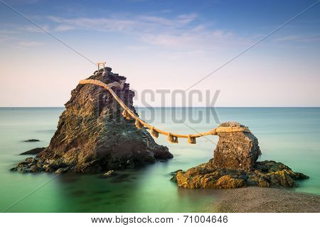 """Meoto Iwa Rocks, Futami, Mie Prefecture, Japan. Known in English as the """"wedded rocks,"""" they are considered sacred and represent husband and wife. poster"""