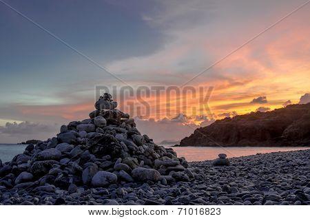 Cairn On Rock Beach Light