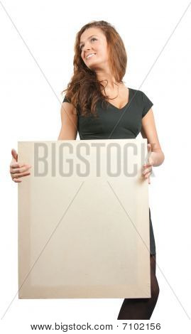 Long Haired Girl In Holds An Empty Poster
