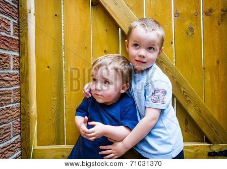 Two Boys Together Looking Up