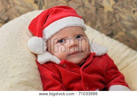 Grumpy Baby In A Santa Suit